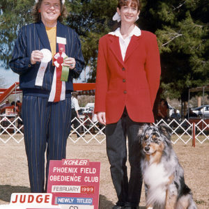 Jazz winning 4th place in Novice B at the PFOC show to finish his AKC CD, February 1999