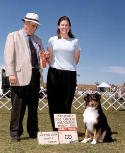 Clover getting a leg towards her AKC CD at Scottsdale Dog Fanciers Ass'n, Scottsdale, AZ March 2001