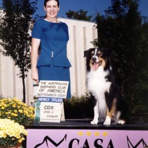 Cody finishing his ASCA CDX at the 2001 ASCA Nationals in Greeley, CO, September 18, 2001. Photo Credit Jan Kohler