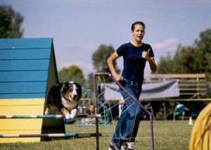 Abbi competing in agility with Emily